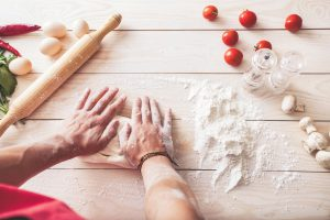 men's hands knead the dough. Ingredients for cooking flour products or dough