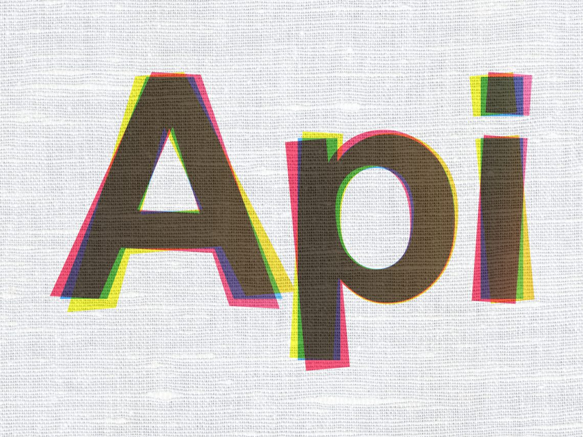 Programming concept: CMYK Api on linen fabric texture background